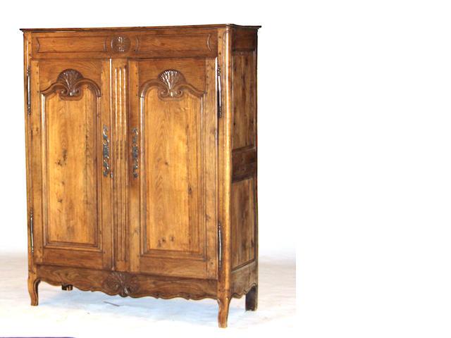 A Louis XV Provincial oak side cabinet third quarter 18th century