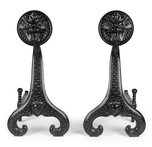 A pair of Bradley & Hubbard cast-iron andirons circa 1910
