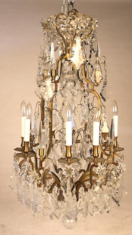 A Rococo style gilt metal and glass eight light chandelier