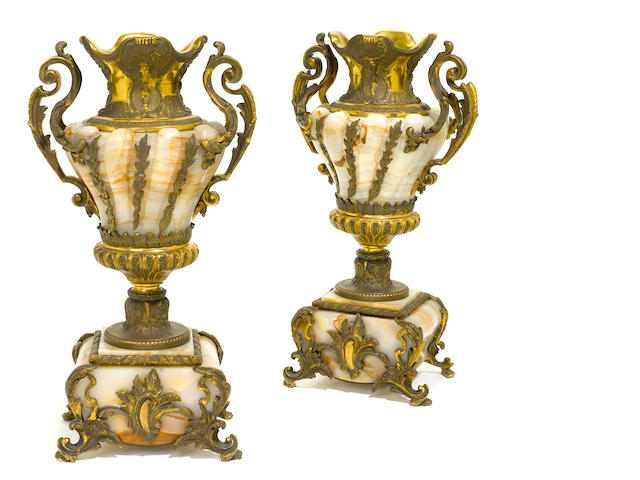 A pair of French gilt bronze and onyx urns <BR />early 20th century