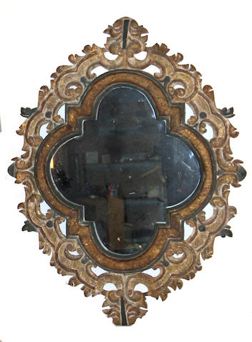 A Baroque style painted and parcel gilt mirror