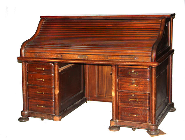 An American Arts and Crafts mahogany roll top desk early 20th century