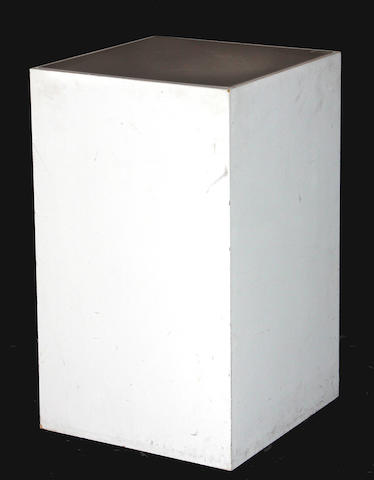 A white painted under lit pedestal of wood and glass  circa 1980