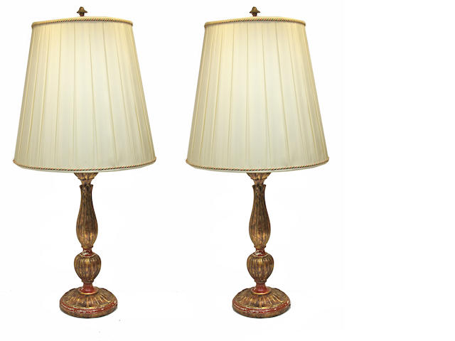 A pair of Baroque style giltwood and monochrome table lamps second half 20th century