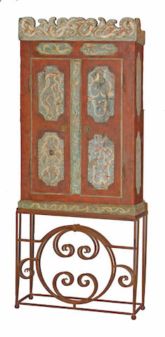 A Spanish Colonial style paint decorated cabinet on stand
