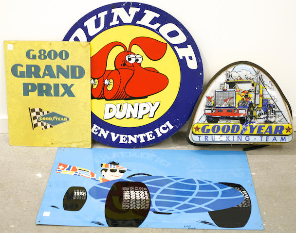 A mixed grouping of tire advertising signs,