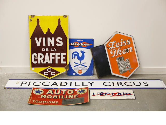 An assembled grouping of advertising signs,