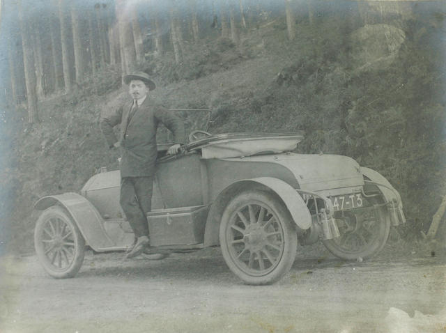 A portrait of a gentleman and his roadster, c. 1914,