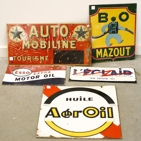 A collection of automotive advertising signs,