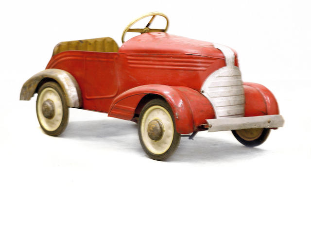 A childs pedal car,