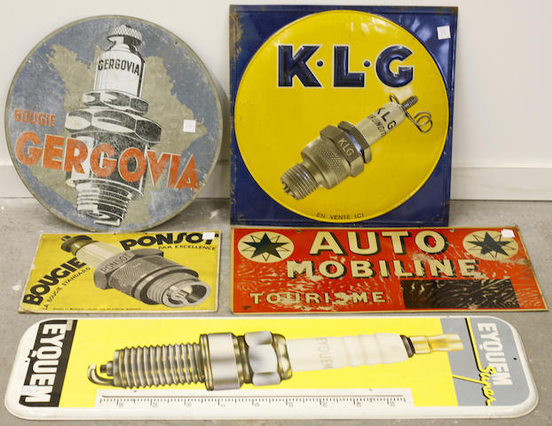 An assembled lot of French spark plug advertising signs,