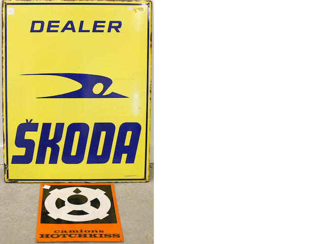 A pair of foreign dealer signs,