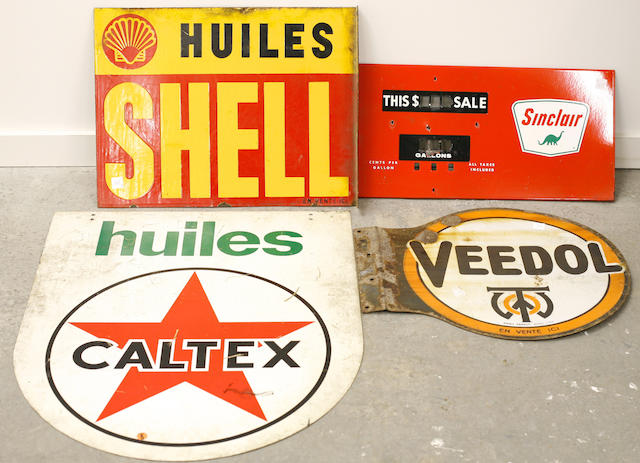 A collection of gas and oil advertising signs,