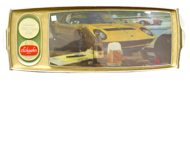 An illuminated Schaeffer beer sign with a Lamborghini Muria.