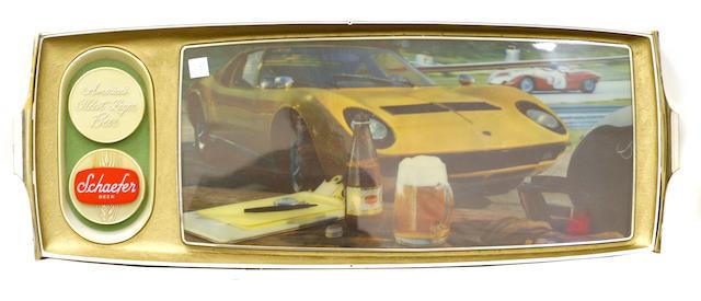 An illuminated Schaeffer beer sign with a Lamborghini Muria.