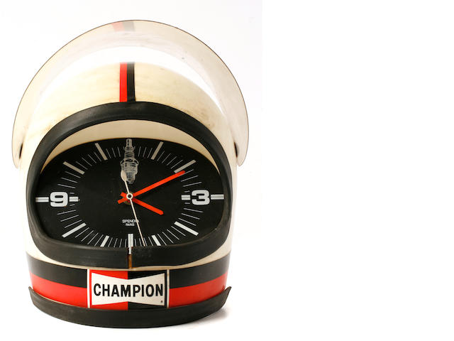 A grouping of Champion spark plugs wall clocks,
