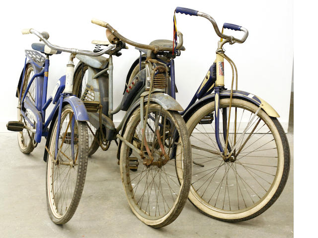 A lot of 3, 50s era girls bicycles,