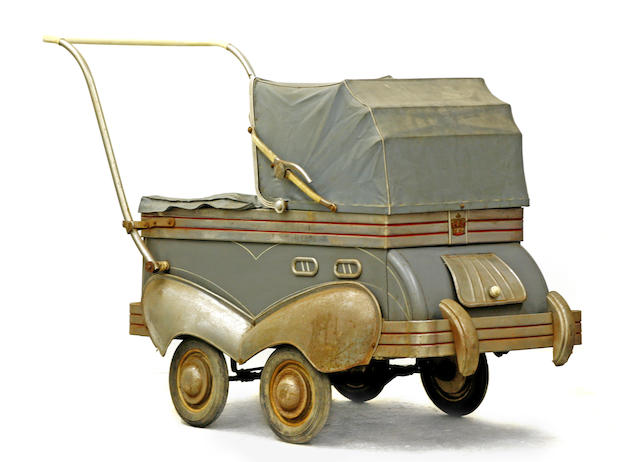 A pre-war baby pram in the shape of a car, c.1930s,