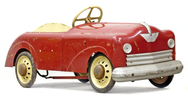 A vintage child's pedal car,