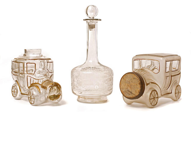 A collection of glass motoring items,