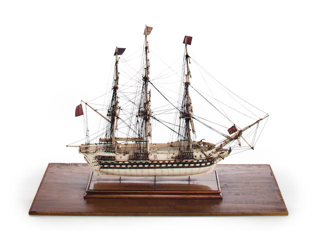 A Napoleonic prisoner-of war-ship model of a 90 gun ship-of-the-line  circa 1805 29-1/2 x 12-7/8 x 22-1/4 in. (74.9 x 30.8 x 56.5 cm.) cased.