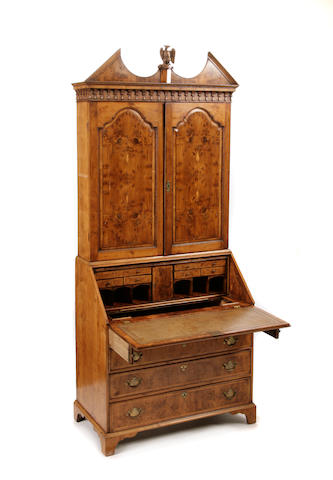 A George III yew wood secretary bookcase