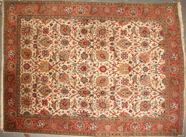 A Tabriz carpet   size approximately 9ft. 3in. x 12ft. 9in.