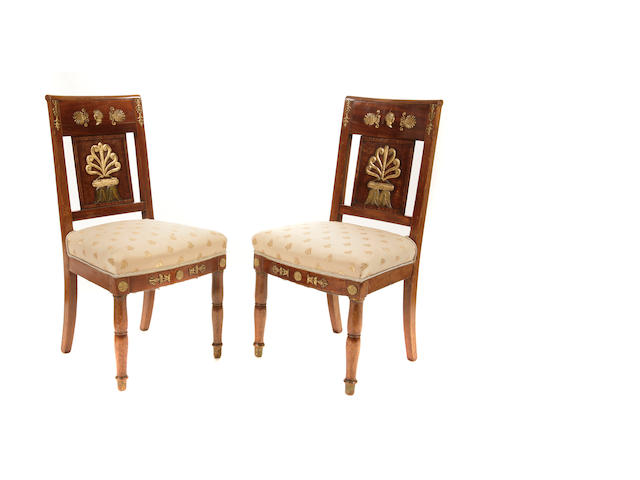 A pair of Empire style gilt bronze mounted walnut side chairs