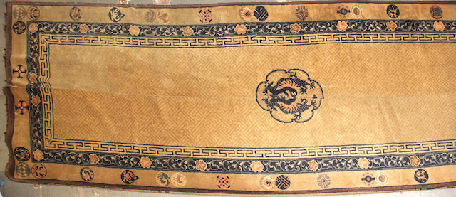 A Chinese Carpet  size approximately 13ft. 2in. x 31ft.