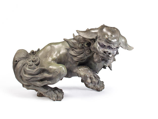 A Massive Cast Bronze sculpture of a Karashishi (lion dog) with modern travertine or other stone fitted base (minor damage to head)  Japan, Meiji period (1868-1912)