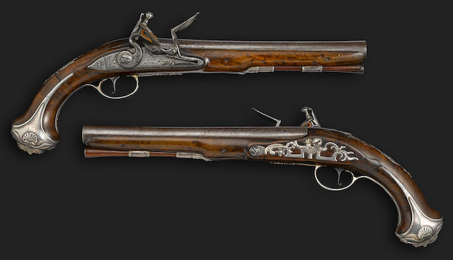 A fine pair of silver mounted flintlock pistols by Griffin -Select US Arms Type-