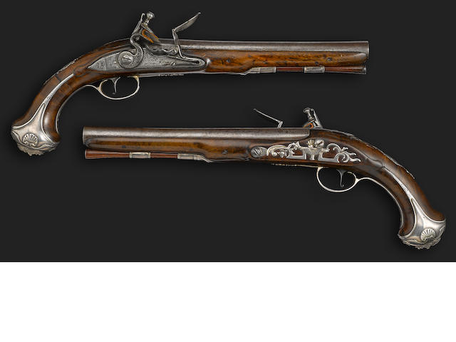 A fine pair of silver mounted flintlock pistols by Griffin