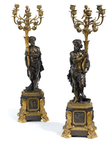 A pair of French gilt and patinated bronze five light candelabra  second half 19th century