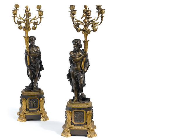 A pair of French gilt and patinated bronze five light candelabra <BR />second half 19th century