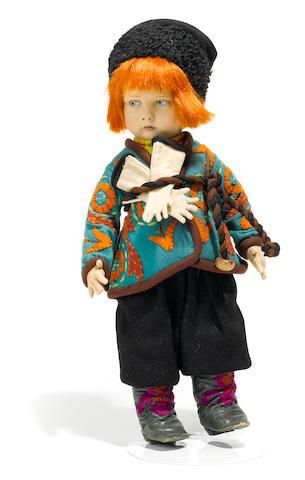 A Lenci felt boy doll in traditional Russian costume