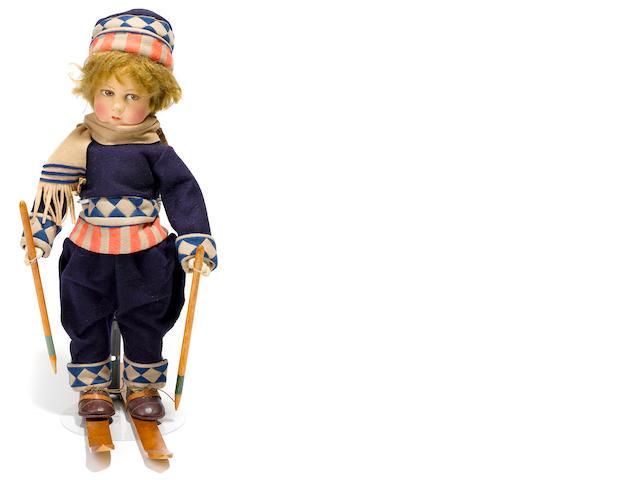 A Lenci felt doll of a skier
