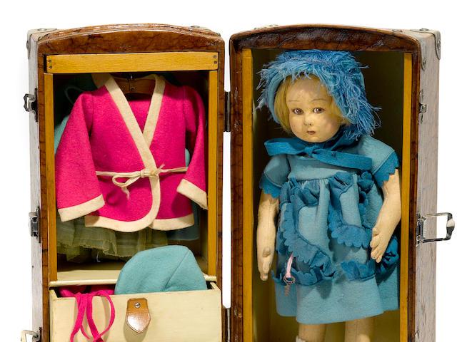 A Lenci felt girl doll with rare trunk