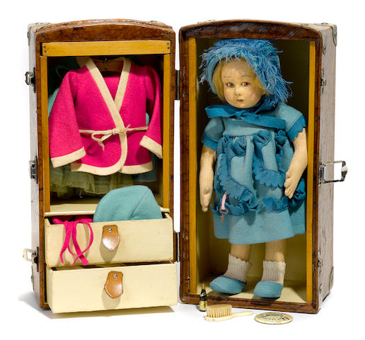 A Lenci felt girl doll with rare trunk