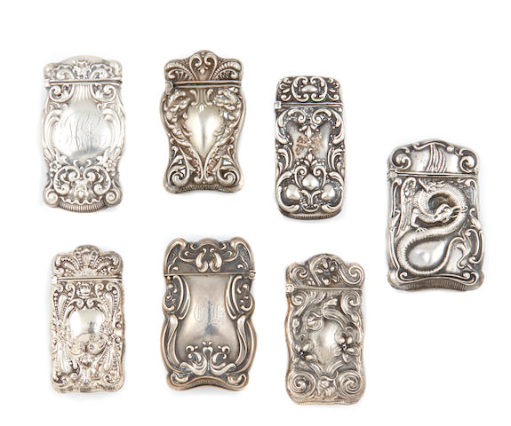An assembled group of American sterling silver repousse-decorated vesta cases by various makers, 19th / 20th century