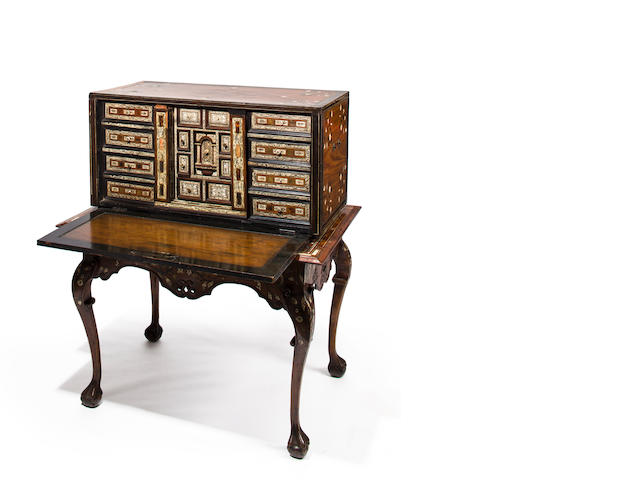 A Spanish Baroque engraved ivory and horn inlaid ebony, mahogany and hardwood cabinet on standthe cabinet interior Spanish, early 18th century, the case and stand Colonial, mid-18th century