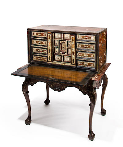 A Spanish Baroque engraved ivory and horn inlaid ebony, mahogany and hardwood cabinet on stand<BR />the cabinet interior Spanish, early 18th century, the case and stand Colonial, mid-18th century