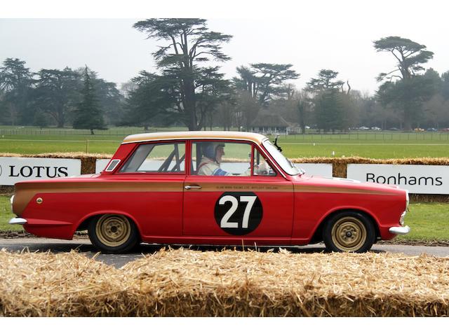 Sir John Whitmore drives the Lotus Cortina at Goodwood