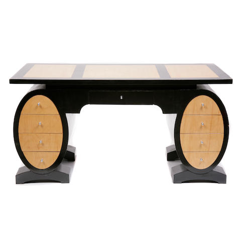 An Art Deco style parcel ebonized desk