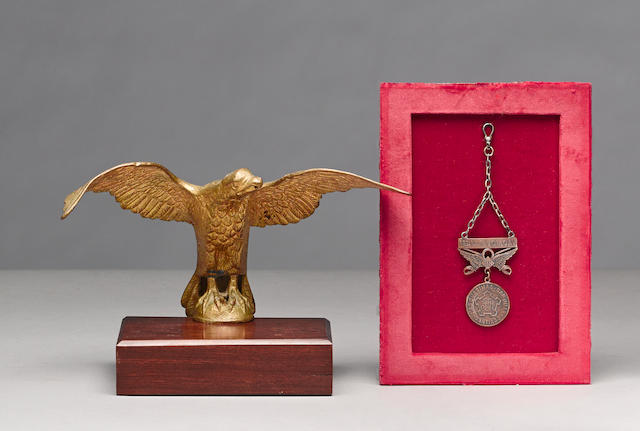A 1st U.S. Volunteer Cavalry Rough Rider's medal and flagpole eagle attributed to the Charge at San Juan Hill -Select US Arms Type-