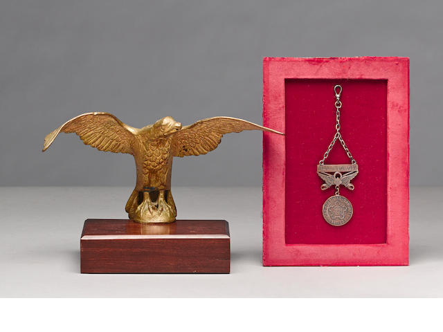 A 1st U.S. Volunteer Cavalry Rough Rider's medal and flagpole eagle attributed to the Charge at San Juan Hill