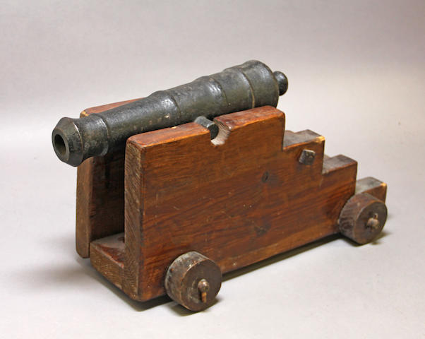 An iron signal cannon on naval style carriage -Select US Arms Type-