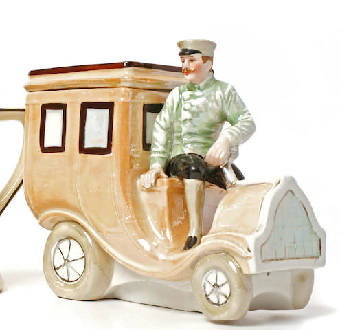 A ceramic motoring candy container,
