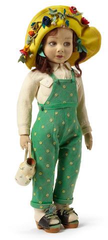 A rare Lenci felt girl doll dressed as a gardener