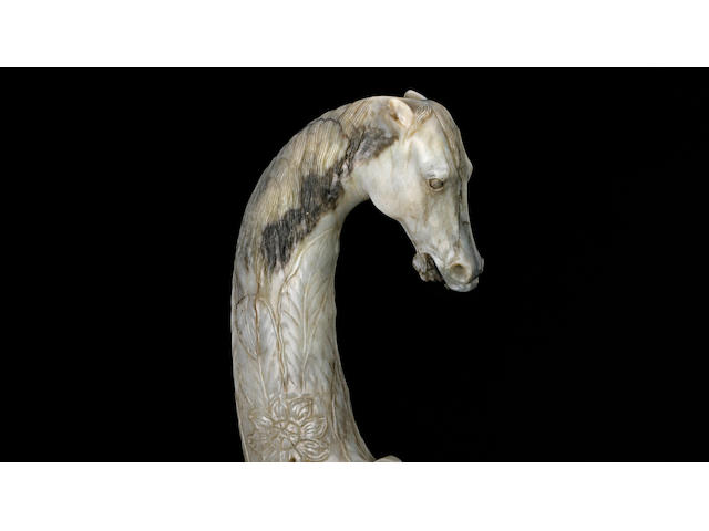 An elegantly carved grayish-white jade sword hilt Kangxi period