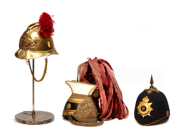 A group of three antique fireman's helmets